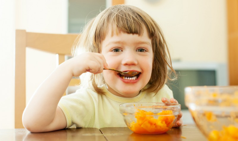 2-year-old-child-eats-mashed-carrot